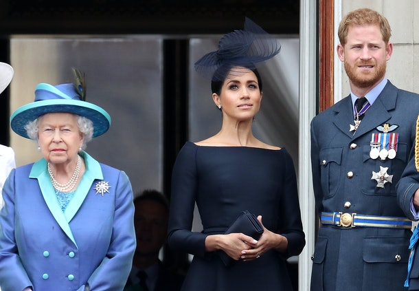 LONDON, ENGLAND - JULY 10: Queen Elizabeth II, Prince Harry, Duke of Sussex and Meghan, Duchess of Sussex on the balcony of Buckingham Palace as the Royal family attend events to mark the Centenary of the RAF on July 10, 2018 in London, England. (Photo by Chris Jackson/Getty Images)