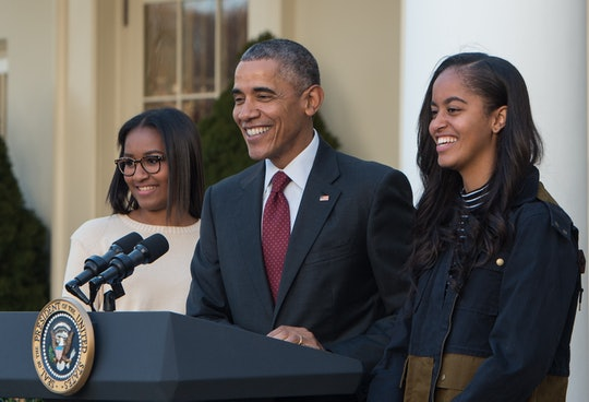 "US President Barack Obama speaks next to daughters Malia (R) and Sasha before ""pardoning"" the National Thanksgiving Turkey in the Rose Garden at the White House in Washington, DC, on November 25, 2015. The President pardoned Honest and his alternate Abe, both 18-week old, 40-pound turkeys. The names of the turkeys were chosen from submissions from California school children. After the pardoning, the turkeys will be on display for visitors at their permanent home at Morven Parks Turkey Hill, the historic turkey farm located at the home of former Virginia Governor Westmoreland Davis (1918-1922) in Leesburg, Virginia.  AFP PHOTO/NICHOLAS KAMM / AFP / NICHOLAS KAMM        (Photo credit should read NICHOLAS KAMM/AFP via Getty Images)"
