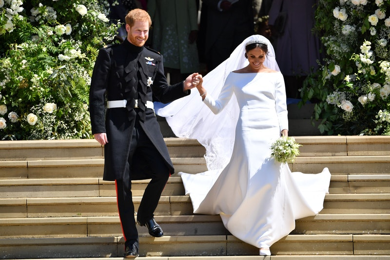 """(FILES) In this file photo taken on May 19, 2018, Britain's Prince Harry, Duke of Sussex and his wife Meghan, Duchess of Sussex emerge from the West Door of St George's Chapel, Windsor Castle, in Windsor, after their wedding ceremony. - Prince Harry has paid back £2.4 million ($3.2 million) of British taxpayers' money used to renovate his home at Windsor Castle, using cash from his recent Netflix deal, his spokesman said on Monday. The Duke of Sussex, as he is formally known, and his wife, American former actress Meghan Markle, retired from royal duties earlier this year in a quest for """"financial independence"""". In doing so, the couple said they were giving up their taxpayer-funded income, and promised to reimburse the public money used to renovate their Frogmore House home. Harry's spokesman said: """"A contribution has been made to the Sovereign Grant by the Duke of Sussex."""" (Photo by Ben STANSALL / AFP) (Photo by BEN STANSALL/AFP via Getty Images)"""
