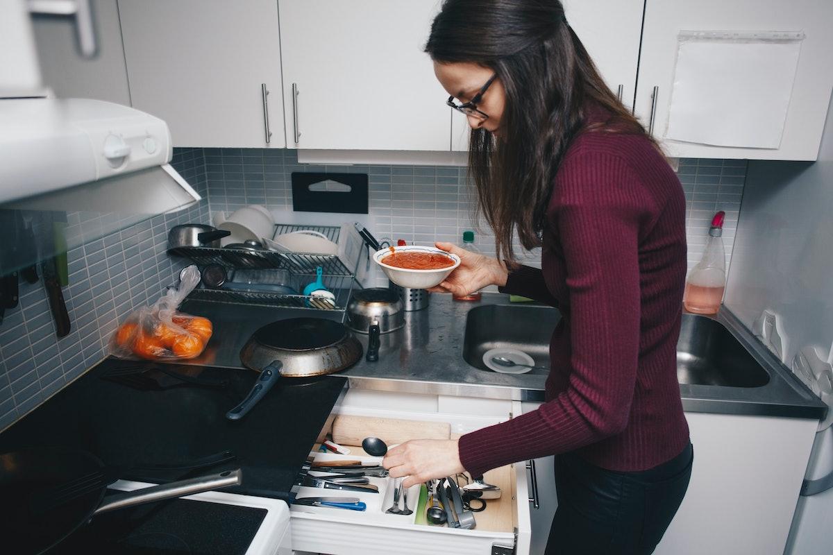 A woman in her kitchen recreates this tomato soup recipe on TikTok.