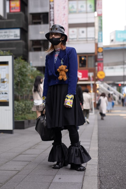 TOKYO, JAPAN - MARCH 20: A guest is seen on the street wearing a Charles Jeffery Loverboy outfit wit...
