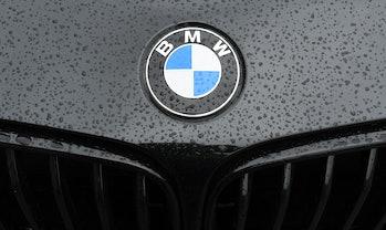 BMW logo on the hood of a black car.