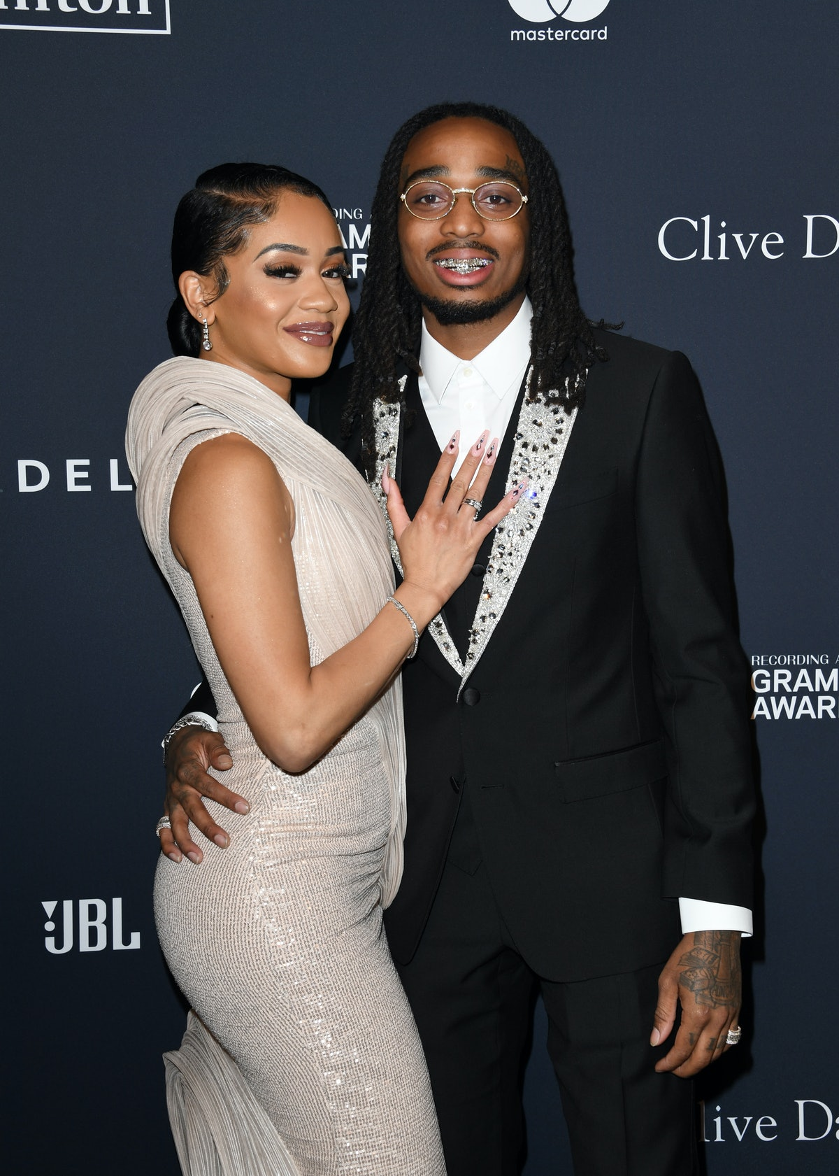 BEVERLY HILLS, CALIFORNIA - JANUARY 25: (L-R) Saweetie and Quavo attend the Pre-GRAMMY Gala and GRAM...