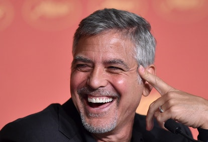 """US actor George Clooney laughs on May 12, 2016 during a press conference for the film """"Money Monster"""" at the 69th Cannes Film Festival in Cannes, southern France.  / AFP / ALBERTO PIZZOLI        (Photo credit should read ALBERTO PIZZOLI/AFP via Getty Images)"""