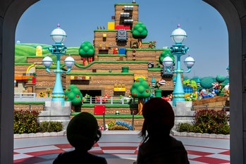 In this picture taken on March 17, 2021, fans of Universal Studio Japan visit Super Nintendo World, during a media preview of the theme park in Osaka. (Photo by Philip FONG / AFP) (Photo by PHILIP FONG/AFP via Getty Images)