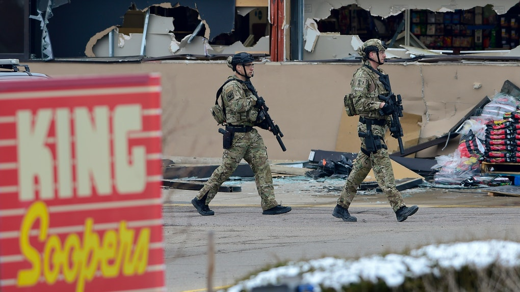 BOULDER, CO - March 22:Armed police officers are seen outside broken windows at King Soopers on Table Mesa Drive in Boulder after reports of shots fired on Monday, March 22, 2021. (Photo by Matthew Jonas/MediaNews Group/Boulder Daily Camera via Getty Images)