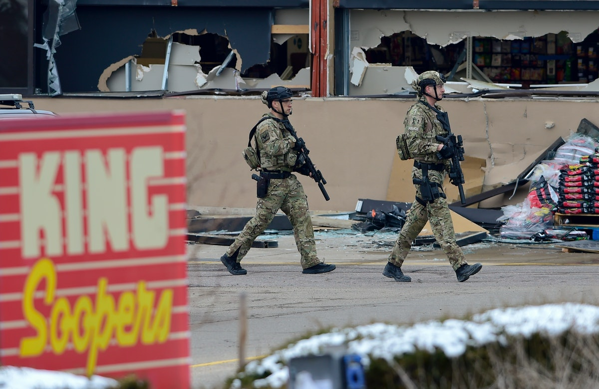 BOULDER, CO - March 22:Armed police officers are seen outside broken windows at King Soopers on Tabl...