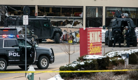 BOULDER, CO - MARCH 22: Smashed windows are left at the scene after a gunman opened fire at a King Sooper's grocery store on March 22, 2021 in Boulder, Colorado. Ten people, including a police officer, were killed in the attack.   (Photo by Chet Strange/Getty Images)