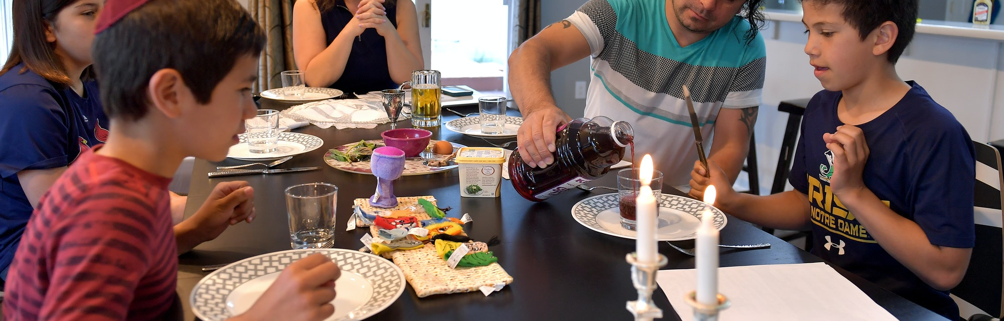 CLARK, NEW JERSEY - APRIL 08: (L-R) Jeremy Valencia, Daniel Valencia, Jennifer Valencia, Jhon Valencia and Eric Valencia celebrate Passover at home on April 08, 2020 in Clark, New Jersey. Passover began at sundown and ends Thursday evening, April 16.  (Photo by Michael Loccisano/Getty Images)