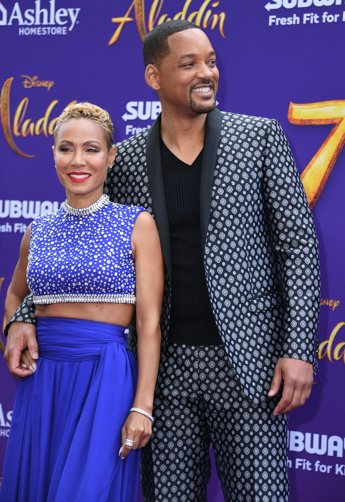 US actor Will Smith and his wife actress Jada Pinkett Smith attend the World Premiere of Disneys Ala...