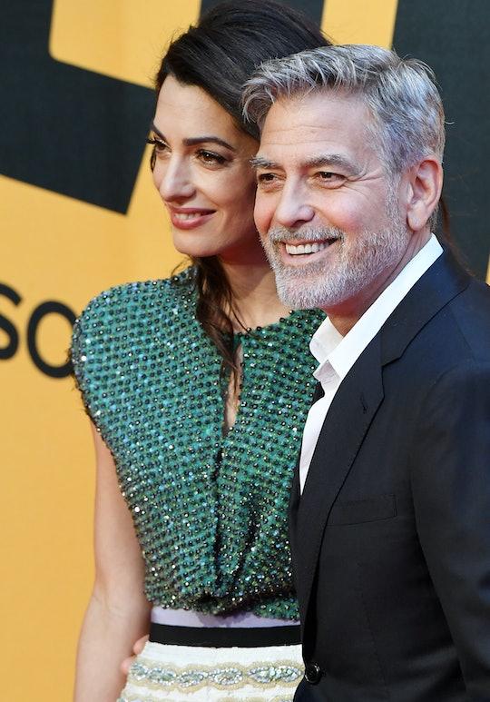 George Clooney et sa femme Amal Alamuddin assistent à la première de la série TV 'Catch-22' le 13 mai 2019 à Rome, Italie. (Photo by Maurix/GAMMA-RAPHO/Gamma-Rapho via Getty Images)