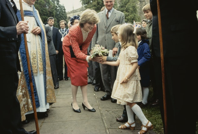 Newly engaged Diana Spencer chats with a young fan.