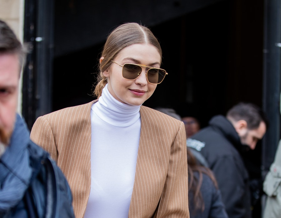 PARIS, FRANCE - FEBRUARY 27: Gigi Hadid is seen wearing camel blazer and asymmetric pants outside Chloe during Paris Fashion Week Womenswear Fall/Winter 2020/2021 : Day Four on February 27, 2020 in Paris, France. (Photo by Christian Vierig/GC Images)