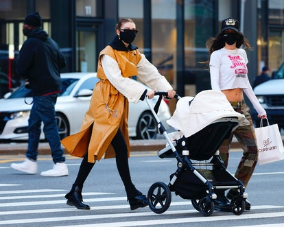 Gigi Hadid takes her daughter Khai shopping in a stroller in Soho on March 22, 2021 in New York City.