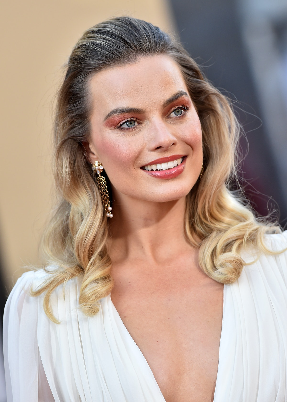 Margot Robbie is wearing a modified take on the bump — a major 2000s hairstyle.
