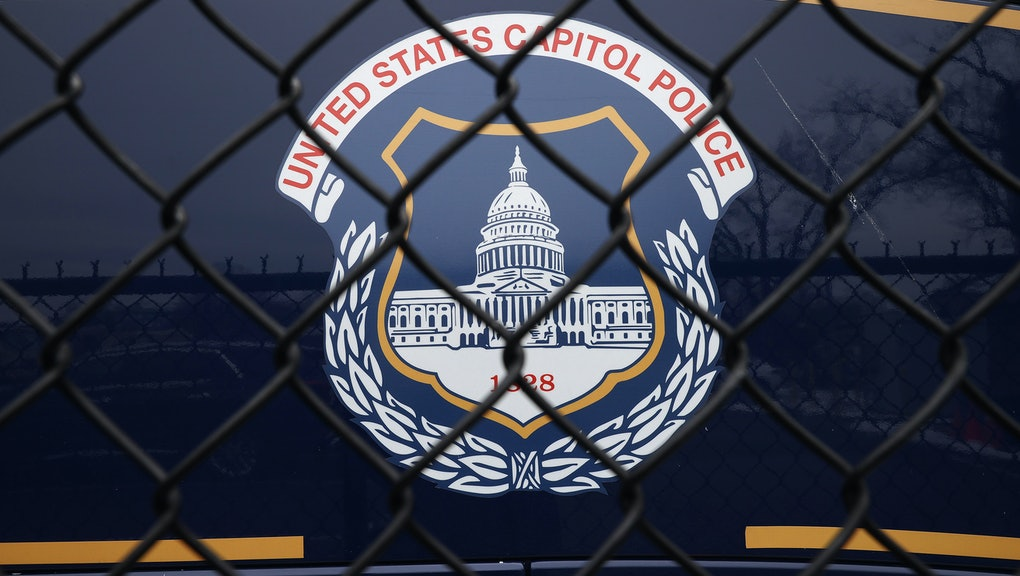 WASHINGTON, DC - FEBRUARY 19: The United States Capitol Police seal appears on the side of a bus parked near the headquarters on February 19, 2021 in Washington, DC. The Capitol Police announced Thursday that it has suspended six officers with pay and placed an additional 29 officers under investigation for their actions during the January 6 insurrectionist attack on the Capitol, which resulted in Officer Brian Sicknick's death. The former Capitol Police chief and the former House and Senate Sergeants at Arms have been called to testify before the Senate Homeland Security Committee next week. (Photo by Chip Somodevilla/Getty Images)