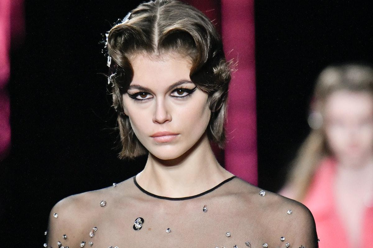 PARIS, FRANCE - MARCH 03: Kaia Gerber walks the runway at the Miu Miu Ready to Wear fashion show as ...