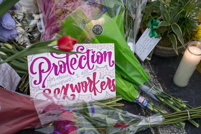 ATLANTA, GA - MARCH 19: A sign sits at the memorial outside of The Gold Spa it reads Protection for Asian, immigrant, and all sex workers on March 19, 2021 in Atlanta, Georgia. Mourners have gathered across the United States to pay respect to the Asian community after suspect Robert Aaron Long, 21, attacked three spas killing eight people, six of whom were Asian. (Photo by Megan Varner/Getty Images)
