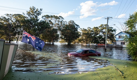 SYDNEY, AUSTRALIA - MARCH 24: A car is seen half submerged in the flood on March 24, 2021 in Sydney, Australia. Recovery and flood clean up begins for parts of Western Sydney following days of continuous rain leading to dozens of communities declared disaster zones. (Photo by Flavio Brancaleone/Getty Images)
