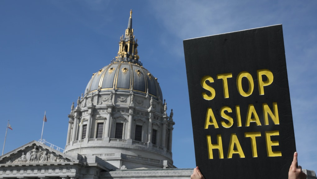 SAN FRANCISCO, CA - MARCH 22: A demonstrator holds a sign saying Stop Asian Hate as they march toward City Hall after rallying in front of the Hall of Justice as they demanded justice for Vicha Ratanapakdee on Monday, March 22, 2021 in San Francisco, Calif. Vicha Ratanapakdee died after being pushed to the pavement as he walked through the city's Anza Vista neighborhood. (Lea Suzuki/The San Francisco Chronicle via Getty Images)
