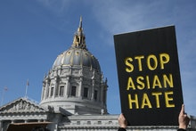SAN FRANCISCO, CA - MARCH 22: A demonstrator holds a sign saying Stop Asian Hate as they march towar...