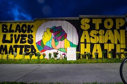 ATLANTA, GA - MARCH 21: Members of the Bad Asian and Civic Walls groups paint a mural near Krog Stre...