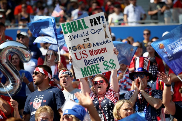 LYON, FRANCE - JULY 07: A USA fan holds a banner protesting the gender pay gap during the 2019 FIFA Women's World Cup France Final match between The United States of America and The Netherlands at Stade de Lyon on July 7, 2019 in Lyon, France. (Photo by Marc Atkins/Getty Images)