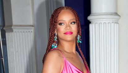 NEW YORK, NY - JUNE 18:  Rihanna wears a hot pink dress when arriving at a Fenty event on June 18, 2...