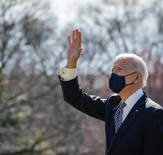 WASHINGTON, DC - MARCH 19: U.S. President Joe Biden waves to First Lady Dr. Jill Biden and family, who were watching from the Truman Balcony, as he walks to Marine One on the South Lawn of the White House on March 19, 2021 in Washington, DC. Biden is traveling to Georgia, where he will visit the Centers for Disease Control and Prevention (CDC) for an update on the coronavirus pandemic and will also meet with Asian-American community leaders after a recent shooting in the Atlanta area that killed eight people. (Photo by Drew Angerer/Getty Images)
