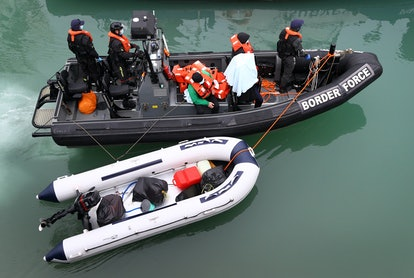 A group of people thought to be migrants are brought in to Dover, Kent, by Border Force officers following a small boat incident in the Channel. Picture date: Monday March 8, 2021. (Photo by Gareth Fuller/PA Images via Getty Images)