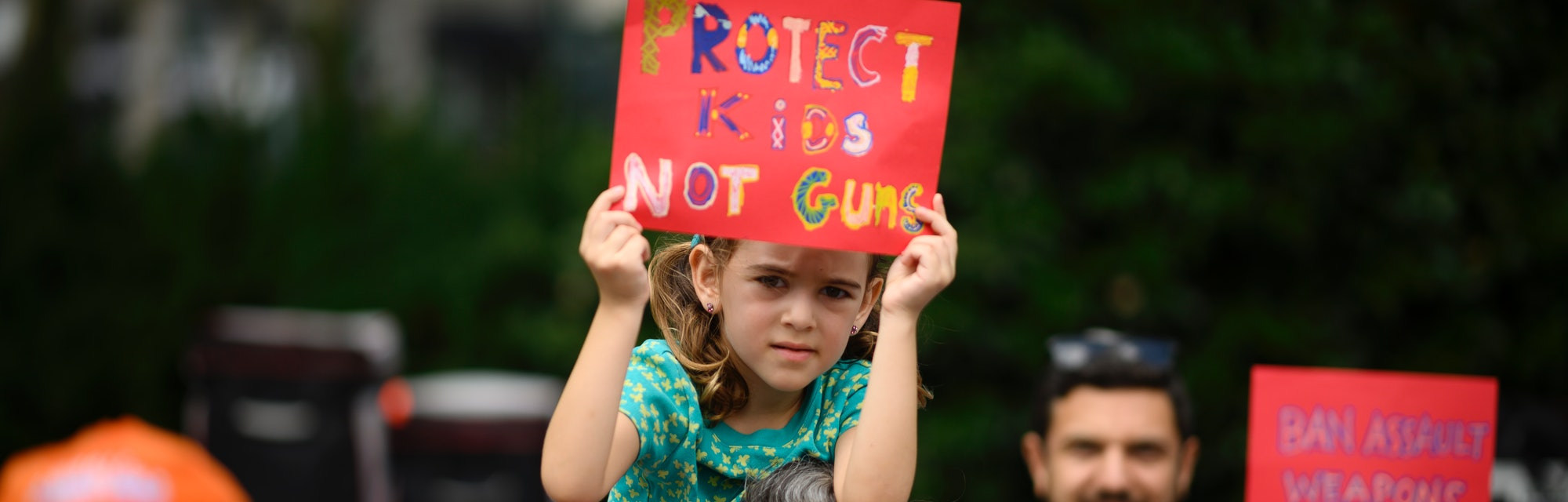 A woman holds her child  as she takes part in a rally of Moms against gun violence and calling for F...