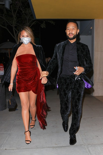 LOS ANGELES, CA - MARCH 14: Chrissy Teigen and John Legend are seen on March 14, 2021 in Los Angeles, California. (Photo by RACHPOOT/MEGA/GC Images)