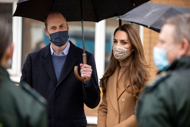 Britain's Prince William, Duke of Cambridge (L) and Britain's Catherine, Duchess of Cambridge, both wearing face coverings due to Covid-19, talk with members of the ambulance service in the wellbeing garden during a visit to Newham Ambulance Station in east London on March 18, 2021, where they learned about their experiences during the coronavirus pandemic. (Photo by RICHARD POHLE / POOL / AFP) (Photo by RICHARD POHLE/POOL/AFP via Getty Images)