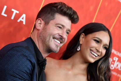 BEVERLY HILLS, CA - OCTOBER 18:  Robin Thicke and April Love Geary attend the amfAR Gala Los Angeles...