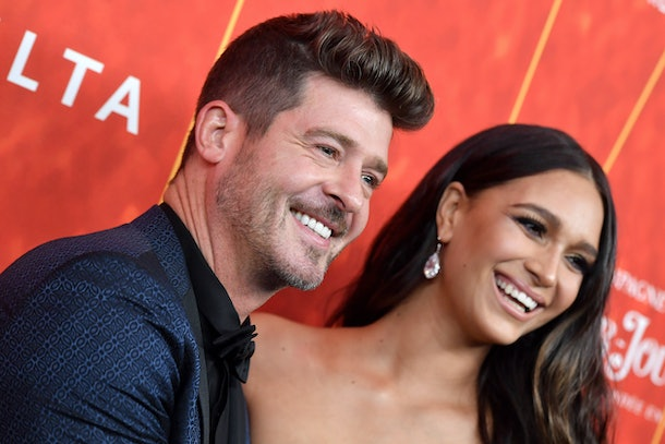 BEVERLY HILLS, CA - OCTOBER 18:  Robin Thicke and April Love Geary attend the amfAR Gala Los Angeles 2018 at Wallis Annenberg Center for the Performing Arts on October 18, 2018 in Beverly Hills, California.  (Photo by Axelle/Bauer-Griffin/FilmMagic)