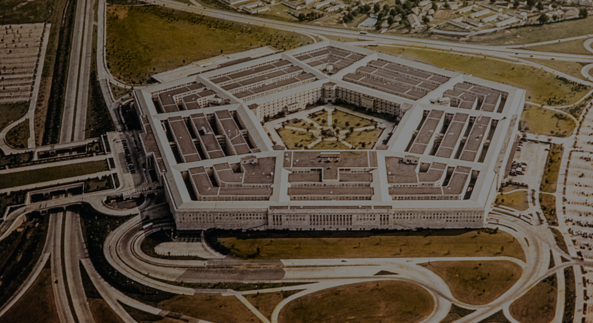 Washington during the 1950's. The United States Department of Defense is an executive branch department of the federal government charged with coordinating and supervising all agencies and functions of the government directly related to national security and the United States Armed Forces. Aerial of the Pentagon, the Department of Defense headquarters in Arlington, Virginia, near Washington DC, with I-395 freeway on the left, and the Air Force Memorial up middle.