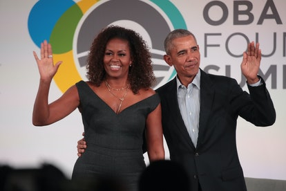 CHICAGO, ILLINOIS - OCTOBER 29: Former U.S. President Barack Obama and his wife Michelle close the O...