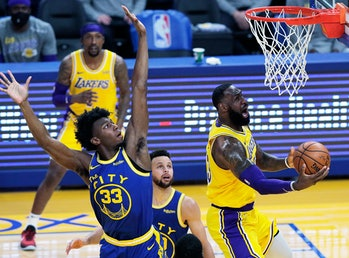 lebron james making a screaming face during an NBA basketball game