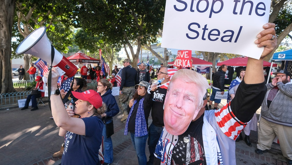 Supporters of US President Donald Trump protest in Los Angeles, California, on January 6, 2021. - Trump supporters, fueled by his spurious claims of voter fraud, are protesting the expected certification of Joe Biden's White House victory by the US Congress on January 6. (Photo by RINGO CHIU / AFP) (Photo by RINGO CHIU/AFP via Getty Images)