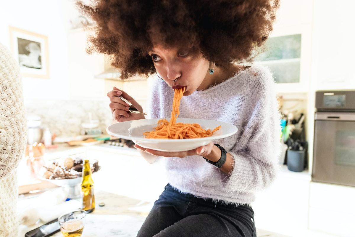 A woman enjoys one of TikToks recipes using ramen to make lasagna and other cheesy dishes.