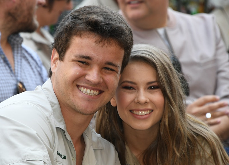 (L-R) Wakeboarder Chandler Powell and conservationist and TV personality  Bindi Irwin pose for a photo at the ceremony for Steve Irwin, who was honored posthumously with a Star on the Hollywood Walk of Fame in Hollywood, California on April 26, 2018. (Photo by Mark RALSTON / AFP)        (Photo credit should read MARK RALSTON/AFP via Getty Images)