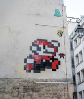 PARIS, FRANCE - APRIL 07:  Street art by artist Invader, showing the video game Mario charatcter from Nintendo, in the 4th quarter of Paris, on April 7, 2018 in Paris, France.  (Photo by Edward Berthelot/Getty Images)