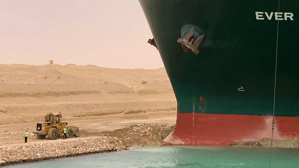 A handout picture released by the Suez Canal Authority on March 24, 2021 shows a part of the Taiwan-owned MV Ever Given (Evergreen), a 400-metre- (1,300-foot-) long and 59-metre wide vessel, lodged sideways and impeding all traffic across the waterway of Egypt's Suez Canal. - A giant container ship ran aground in the Suez Canal after a gust of wind blew it off course, the vessel's operator said on March 24, 2021, bringing marine traffic to a halt along one of the world's busiest trade routes. (Photo by Suez Canal Authority/HO/AFP via Getty Images)