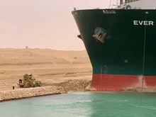 A handout picture released by the Suez Canal Authority on March 24, 2021 shows a part of the Taiwan-...
