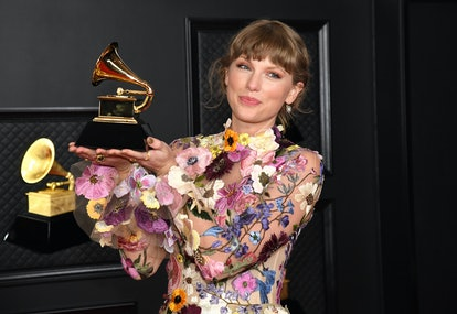 LOS ANGELES, CALIFORNIA - MARCH 14: Taylor Swift, winner of Album of the Year for 'Folklore', poses ...
