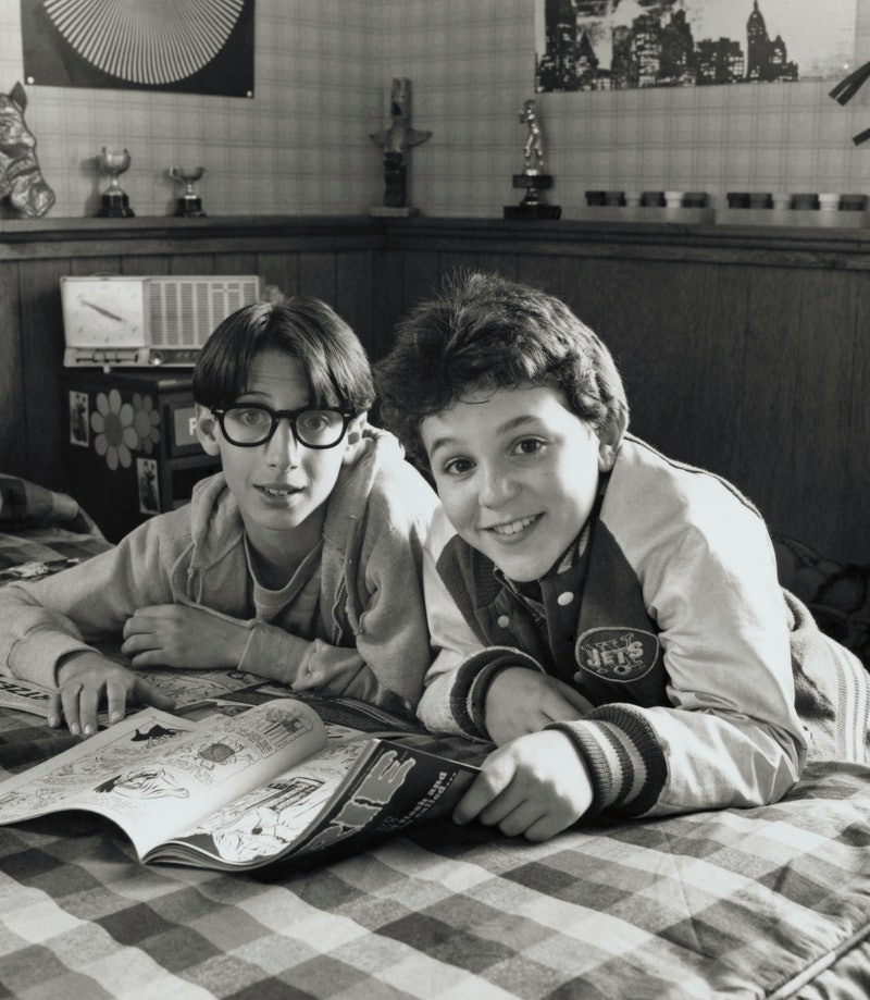 (Original Caption) The Wonder Years. Kevin Arnold (Fred Savage, right) and his best friend Paul (Josh Saviano, left) engage in a favorite pastime in the comedy series that focuses on an adult's memories of his entry into adolescence during the restless '60's. The program airs Wednesdays (9:00 to 9:30 PM, ET), on the ABC Television Network.