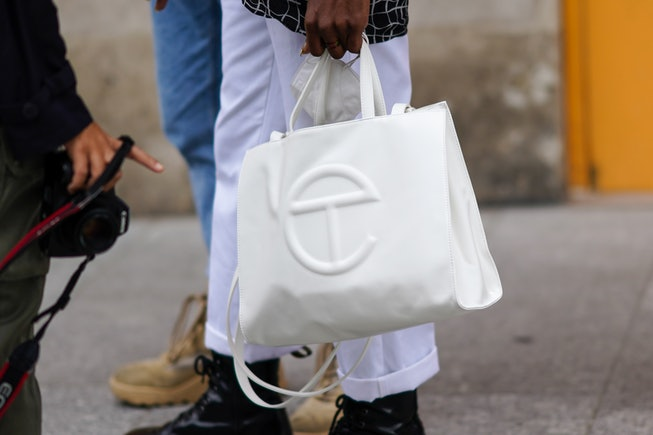 PARIS, FRANCE - OCTOBER 06: A guest wears a white Telfar leather bag, outside Louis Vuitton, during Paris Fashion Week - Womenswear Spring Summer 2021, on October 06, 2020 in Paris, France. (Photo by Edward Berthelot/Getty Images)