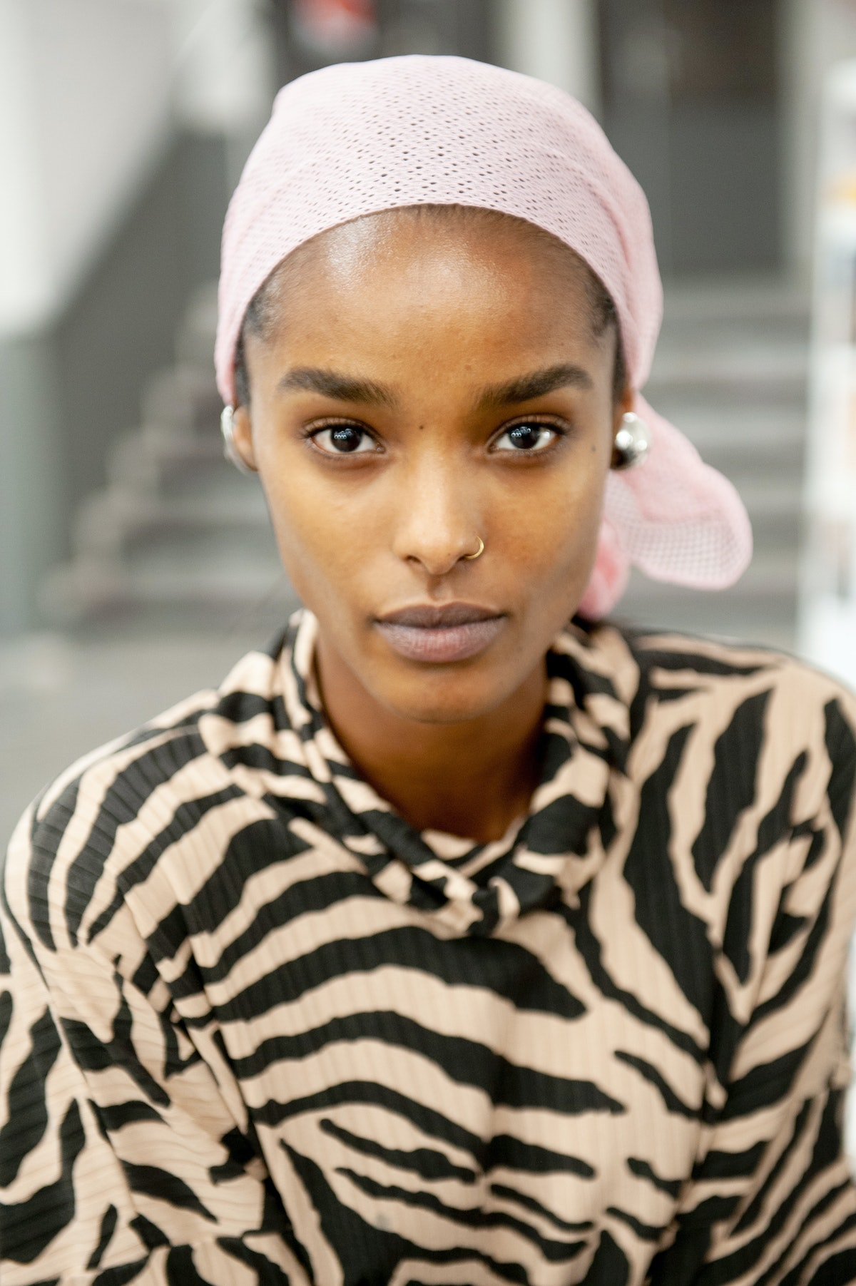 PARIS, FRANCE - MARCH 04: (EDITORIAL USE ONLY) A model prepares backstage prior to the Coperni show ...