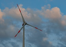 26 March 2021, Brandenburg, Sieversdorf: A wind turbine in front of clouds. Photo: Patrick Pleul/dpa...
