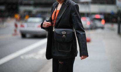 HAMBURG, GERMANY - MARCH 17: Tugba Kement wearing black NA-KD leather blazer, orange Zara top, black...